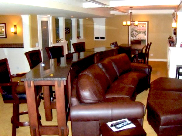 behind the bar is a pool room with am 8u0027 pool table and a wet bar with a built in beverage center and ice maker there is a great deal of granite
